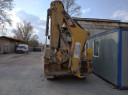 Caterpillar 428F2 з гідромолотом CAT H70d